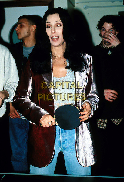 CHER.Ref:1966/1501f.playing table tennis, paddle, ping pong, brown leather jacket, half length, half-length.www.capitalpictures.com.sales@capitalpictures.com.© Capital Pictures