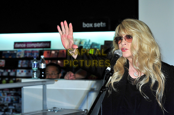 Stevie Nicks.Signing Session at HMV Oxford Street, London, England..June 27th, 2011.half length black suit jacket sunglasses shades singing microphone hand arm waving .CAP/CJ.©Chris Joseph/Capital Pictures.