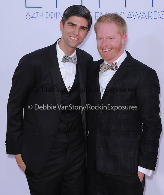 Jesse Tyler Ferguson, Justin Mikita.. at The 64th Anual Primetime Emmy Awards held at Nokia Theatre L.A. Live in Los Angeles, California on September  23,2012                                                                   Copyright 2012 Hollywood Press Agency