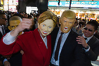 Revellers wearing masks featuring Donald Trump, Hillary Clinton and Barack Obama during the Halloween celebrations in Shibuya, Tokyo, Japan. Saturday October 29th 2016 Halloween celebration in Japan have grown massively in the last few years. To ensure the safety of the crowds in Shibuya this year, the police closed several roads leading to the famous Hachiko Square, allowing costumed revellers to spread over a larger area.