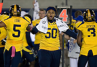 Aaron Tipoti of California celebrates with California defenders Michael Lowe and Kameron Jackson after making big plays against UCLA at Memorial Stadium in Berkeley, California on October 6th, 2012.  California defeated UCLA, 43-17.