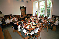 Schoolchildren sitting at tables eating their lunch time meal. This image may only be used to portray the subject in a positive manner..©shoutpictures.com..john@shoutpictures.com