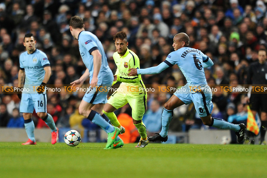 Neymar of Barcelona gets away from Fernando of Manchester City - Manchester City vs Barcelona - UEFA Champions League Round of 16 1st Leg Football at the Etihad Stadium, Greater Manchester - 24/02/15 - MANDATORY CREDIT: Greig Bertram/TGSPHOTO - Self billing applies where appropriate - contact@tgsphoto.co.uk - NO UNPAID USE