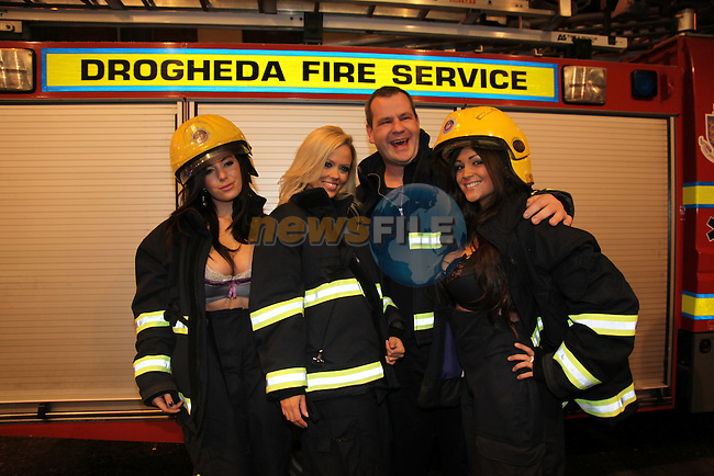 Nuts Girls Malene Espensen (Blonde) Lindsey Strutt and Casey Batchelor Launching the Drogheda Fire and rescue service calender 2010 at the earth night club in Drogheda.Pictured Niall Malone gets in on the action..Photo: Fran Caffrey/www.newsfile.ie...