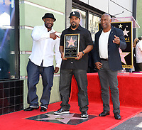 Rapper WC, Ice Cube &amp; John Singleton at the Hollywood Walk of Fame star ceremony honoring actor/musician Ice Cube, Los Angeles, USA 12 June  2017<br /> Picture: Paul Smith/Featureflash/SilverHub 0208 004 5359 sales@silverhubmedia.com