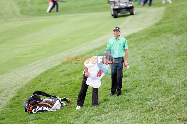 Charl Schwartzel in the rough on 18 in the final round of the Open de Espana in Madrid...Photo NEWSFILE/Manus O'Reilly.(Photo credit should read Manus O'Reilly/NEWSFILE)....This Picture has been sent you under the condtions enclosed by:.Newsfile Ltd..The Studio,.Millmount Abbey,.Drogheda,.Co Meath..Ireland..Tel: +353(0)41-9871240.Fax: +353(0)41-9871260.GSM: +353(0)86-2500958.email: pictures@newsfile.ie.www.newsfile.ie.FTP: 193.120.102.198..