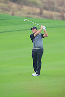 Francesco Molinari (ITA) plays his 2nd shot on the 10th hole during Friday's Round 2 of the 2014 BMW Masters held at Lake Malaren, Shanghai, China 31st October 2014.<br /> Picture: Eoin Clarke www.golffile.ie