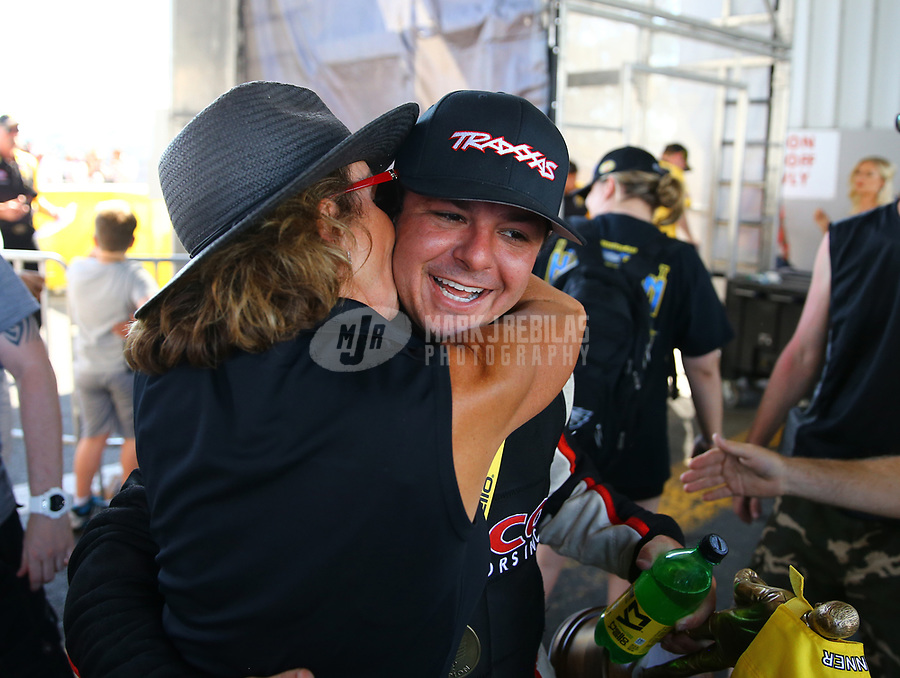 Jun 11, 2017; Englishtown , NJ, USA; NHRA top fuel driver Steve Torrence celebrates with mother Kay Torrence after winning the Summernationals at Old Bridge Township Raceway Park. Mandatory Credit: Mark J. Rebilas-USA TODAY Sports