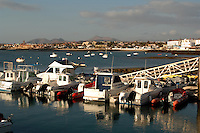 Pleasure yachts and fishing boats moored to jetty, Corralejo harbour,Fuerteventura,Canary Islands,Spain, May 2007