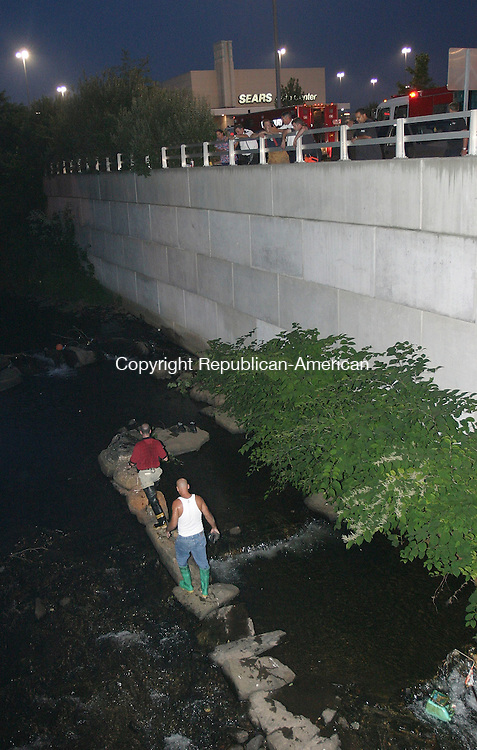 WATERBURY, CT 26 July 2005 -072605BZ06- A Waterbury Police Detective and George Rodriguez make their way back from searching for what Rodriguez thought were human bones in the Mad River near the Brass Mill Center Tuesday night.  <br /> Jamison C. Bazinet Photo