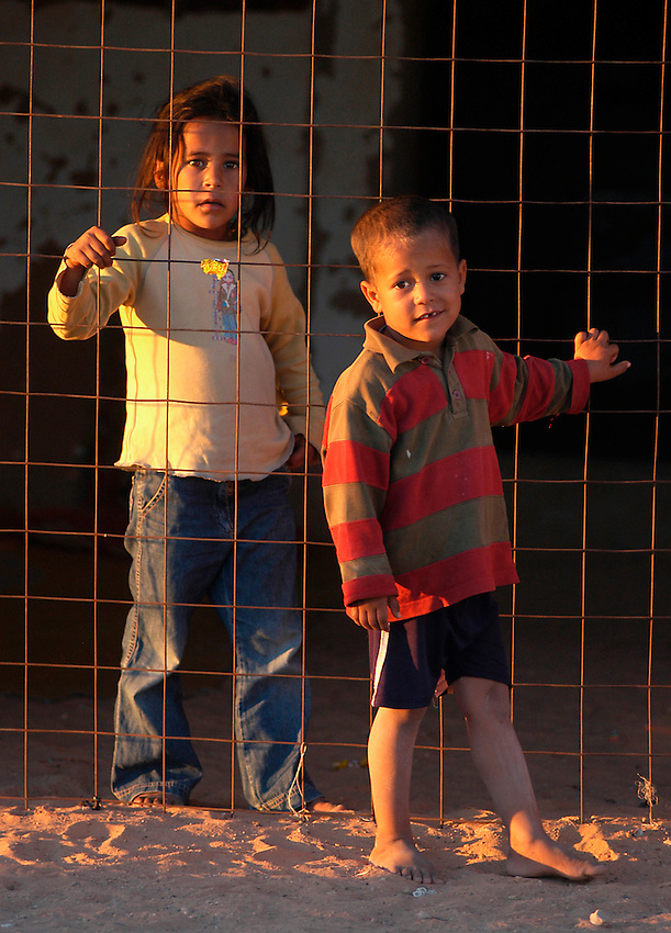Children are pictured on December 14, 2003. Saharawi people have been living at the refugee camps of the Algerian desert named Hamada, or desert of the deserts, for more than 30 years now. Saharawi people have suffered the consecuences of European colonialism and the war against occupation by Moroccan forces. Polisario and Moroccan Army are in conflict since 1975 when Hassan II, Moroccan King in 1975, sent more than 250.000 civilians and soldiers to colonize the Western Sahara when Spain left the country. Since 1991 they are in a peace process without any outcome so far. (Ander Gillenea / Bostok Photo)
