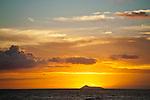 The interesting silhouette of Lehua Island is revelaled during sunset, Kauai, Hawaii