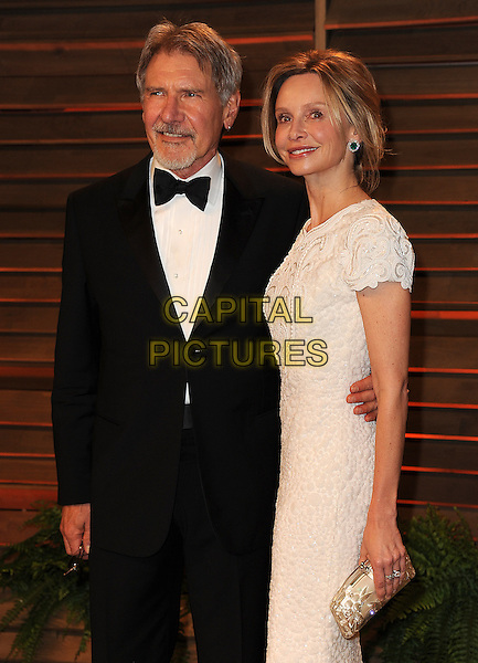 WEST HOLLYWOOD, CA - MARCH 2: Harrison Ford and Calista Flockhart arrive at the 2014 Vanity Fair Oscar Party in West Hollywood, California on March 2, 2014.  <br /> CAP/MPI/MPI213<br /> &copy;MPI213/MediaPunch/Capital Pictures