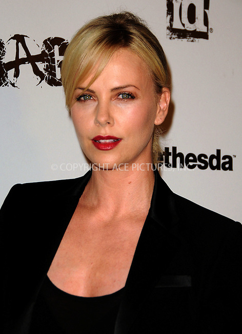 WWW.ACEPIXS.COM . . . . .  ....September 30 2011, LA....Actress Charlize Theron arriving at the 'Rage' video game launch party at Chinatown's Historical Central Plaza on September 30, 2011 in Los Angeles, California.....Please byline: PETER WEST - ACE PICTURES.... *** ***..Ace Pictures, Inc:  ..Philip Vaughan (212) 243-8787 or (646) 679 0430..e-mail: info@acepixs.com..web: http://www.acepixs.com