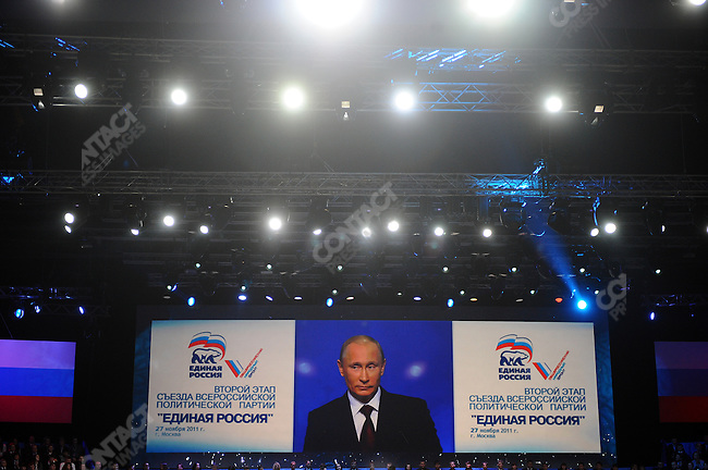 A screen showed Vladimir Putin, the Russian Prime Minister, speaking to delegates at the United Russia Congress in Moscow where his candidature for the upcoming presidential elections in March was approved by the congress. Moscow, Russia, November 27, 2011