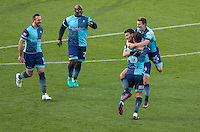 Teammates celebrate Scott Kashket of Wycombe Wanderers first goal with him during the Sky Bet League 2 match between Wycombe Wanderers and Hartlepool United at Adams Park, High Wycombe, England on 26 November 2016. Photo by Kevin Prescod / PRiME Media Images.