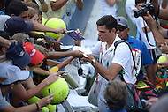 Washington, DC - August 3, 2014: Milos Raonic of Canada autographs memorabilia for fans at the Fitzgerald Tennis Center after winning the Citi Open in straight sets over fellow Canadian Vasek Pospisil, August 3, 2014.  (Photo by Don Baxter/Media Images International)