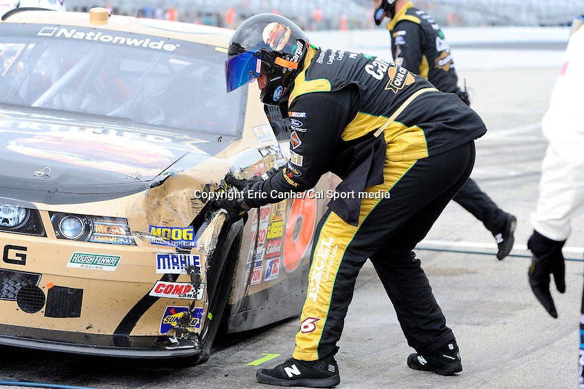 "July 13, 2013 - Loudon, New Hampshire U.S. - A crew member pulls a dented fender on driver Trevor Bayne's (6) car while racing in the NASCAR Nationwide Series CNBC Prime's ""The Profit"" 200 race being held at the New Hampshire Motor Speedway in Loudon, New Hampshire.   Eric Canha/CSM"