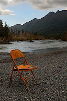 Lonely folding chair on the Eagle River, Alaska.