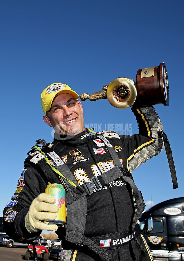 Feb. 24, 2013; Chandler, AZ, USA; NHRA top fuel dragster driver Tony Schumacher celebrates after winning the Arizona Nationals at Firebird International Raceway. Mandatory Credit: Mark J. Rebilas-