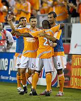 Houston Dynamo forward Chris Wondolowski (7), defender Wade Barrett (24), midfielder Corey Ashe (26), and defender Patrick Ianni (4) celebrate a Dynamo goal. The Houston Dynamo defeated Real Salt Lake 4-3 during an MLS regular season game at Robertson Stadium in Houston, TX on September 8, 2007.