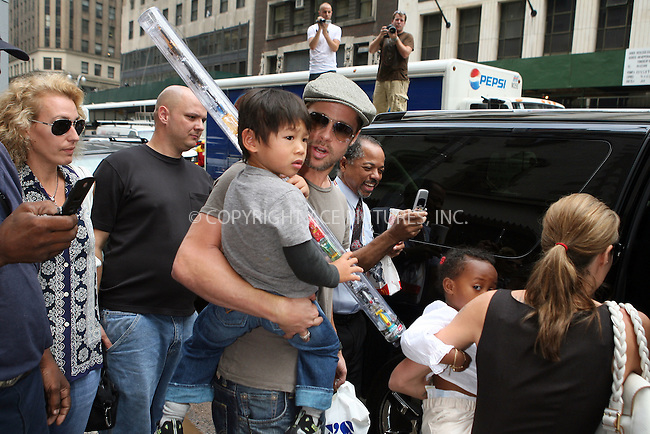 WWW.ACEPIXS.COM . . . . .  ....August 24 2007, New York City....Angelina Jolie and Brad Pitt took their adopted children Zahara, Pax and Maddox for a trip to Lee's Art Shop in midtown Manhattan, bought them toys and gifts and then stopped in Times square on the way back to their hotel, where Brad bought Maddox a pretzel.....Please byline: PHILIP VAUGHAN- ACE PICTURES.... *** ***..Ace Pictures, Inc:  ..tel: (646) 769 0430..e-mail: info@acepixs.com..web: http://www.acepixs.com
