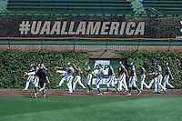 Players stretch on the warning track before the Under Armour All-American Game on August 15, 2015 at Wrigley Field in Chicago, Illinois. (Mike Janes/Four Seam Images)
