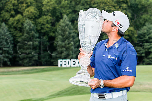August 30, 2015: Jason Day kisses The Barclays trophy after winning The Barclays, shooting a -19, at Plainfield Country Club in Edison, NJ.