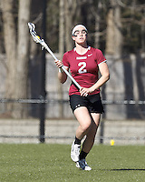 Harvard University midfielder Isabella Wager (2) brings the ball forward.
