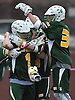 DJ Kellerman #1 Ward Melville goalie, left, John Day #44, center, and Patrick O'Neill #36 celebrate after their team's 9-8 win over host Chaminade High School in a non-league varsity boys lacrosse game on Saturday, Apr. 2, 2016.