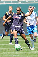 Shannon Boxx #7 of the Los Angeles Sol attacks the defense of the Boston Breakers during thier WPS game at Home Depot Center on May 10, 2009 in Carson, California.