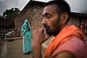 Lal ji (in orange), the present mahant (village priest) is seen outside his house in Village Hanumangarhi, in Bundelkhand area of Uttar Pradesh, India. His father was murdered by the dreaded dacoit,  Ghanshyam gang back in 1976. King of Rampura, Raja Keshwendra Singh (not seen in this picture) still enjoys the stature of a King in this modern day and age.