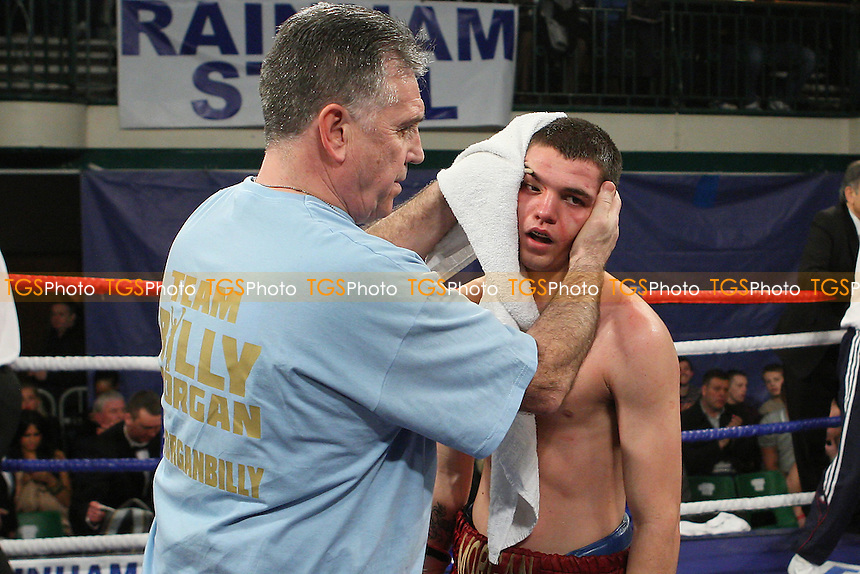 Billy Morgan (claret/blue shorts) defeats Dan Naylor in a Lightweight boxing contest at York Hall, Bethnal Green, promoted by Frank Warren - 10/02/12 - MANDATORY CREDIT: Gavin Ellis/TGSPHOTO - Self billing applies where appropriate - 0845 094 6026 - contact@tgsphoto.co.uk - NO UNPAID USE.