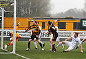 Alloa's Darren Young (6) hits the bar from close range.
