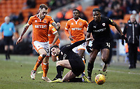 Blackpool's Marc Bola vies for possession with Barnsley's Jared Bird <br /> <br /> Photographer Rich Linley/CameraSport<br /> <br /> The EFL Sky Bet League One - Blackpool v Barnsley - Saturday 22nd December 2018 - Bloomfield Road - Blackpool<br /> <br /> World Copyright &copy; 2018 CameraSport. All rights reserved. 43 Linden Ave. Countesthorpe. Leicester. England. LE8 5PG - Tel: +44 (0) 116 277 4147 - admin@camerasport.com - www.camerasport.com