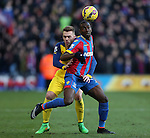 Crystal Palace's Yannick Bolasie tussles with Arsenal's Calum Chambers<br /> <br /> Barclays Premier League - Crystal Palace  vs Arsenal  - Selhurst Park - England - 21st February 2015 - Picture David Klein/Sportimage