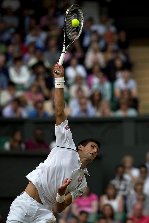 Novak Djokovic (SRB) [1] in action against Marin Cilic (CRO) [9] in their Gentlemen's Singles Fourth Quarter Final match today - Novak Djokovic (SRB) [1] def Marin Cilic (CRO) [9] 6-4 6-4 6-4<br /> <br /> Photographer Stephen White/CameraSport<br /> <br /> Tennis - Wimbledon Lawn Tennis Championships - Day 9 - Wednesday 8th July 2015 -  All England Lawn Tennis and Croquet Club - Wimbledon - London - England<br /> <br /> &copy; CameraSport - 43 Linden Ave. Countesthorpe. Leicester. England. LE8 5PG - Tel: +44 (0) 116 277 4147 - admin@camerasport.com - www.camerasport.com.