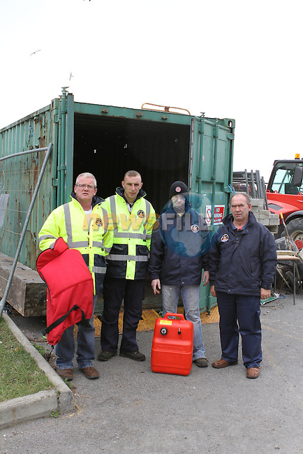 Drogheda River Rescue Members Alan Floyd, Paul Murphy, David Conlon and Eugene Kierans with the container that was broken in to...(Photo credit should read Jenny Matthews www.newsfile.ie)....This Picture has been sent you under the conditions enclosed by:.Newsfile Ltd..The Studio,.Millmount Abbey,.Drogheda,.Co Meath..Ireland..Tel: +353(0)41-9871240.Fax: +353(0)41-9871260.GSM: +353(0)86-2500958.email: pictures@newsfile.ie.www.newsfile.ie.