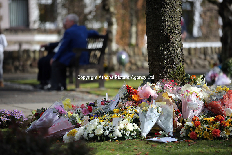 Pictured: Flowers and tributes left at the Memorial Garden Friday 21 October 2016<br />Re: Wales has fallen silent as the country remembered the Aberfan disaster 50 years ago.<br />On 21 October 1966, a mountain of coal waste slid down into a school and houses in the Welsh village, killing 144 people, including 116 children.<br />A day of events to commemorate the disaster included a service at Aberfan Cemetery at 9:15am on Friday.<br />Prince Charles is visiting Aberfan memorial garden before unveiling a plaque in memory of the victims.<br />He will also attend a reception with the families of some of those who lost their lives, before signing a book of remembrance.