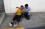 Relatives of Palestinian teenager Belal Khafaja, who was killed by Israeli forces during clashes in tents protest at the Israel-Gaza border,  mourn at a hospital in Rafah in the southern Gaza Strip on September 7, 2018. Photo by Ashraf Amra