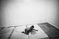 Soyam Rishi (11 years) plays chess at his leisure. Sukma, Chattisgarh, India. Arindam Mukherjee