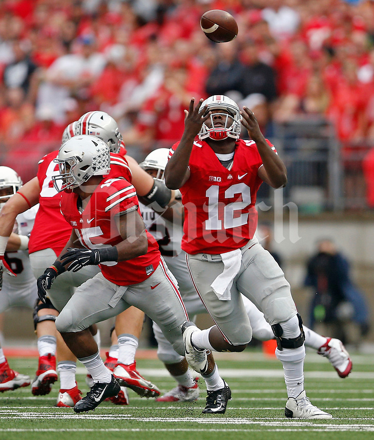 Ohio State Buckeyes quarterback Cardale Jones (12) can't handle the snap against Northern Illinois Huskies during the 1st quarter of their game at Ohio Stadium on September 19, 2015.  (Dispatch photo by Kyle Robertson)