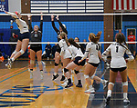 Althoff's Karinna Gall (left) leaps to smash the ball against Incarnate Word  as other team members maneuver into position during gold division pool play. The teams competed in the 21st Annual Metro Classic Volleyball Tournament at Belleville East High School on Saturday September 29, 2018. Tim Vizer/Special to STLhighschoolsports.com