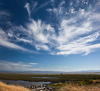 Delicate feathers of cirrus clouds float over a landscape that stretches from wetland marsh to San Francisco Bay and then Santa Cruz Mountains.