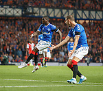 19.09.2019 Rangers v Feyenoord: Sheyi Ojo lashes the ball into the net to score meanwhile Borna Barisic is screaming at him looking for a pass