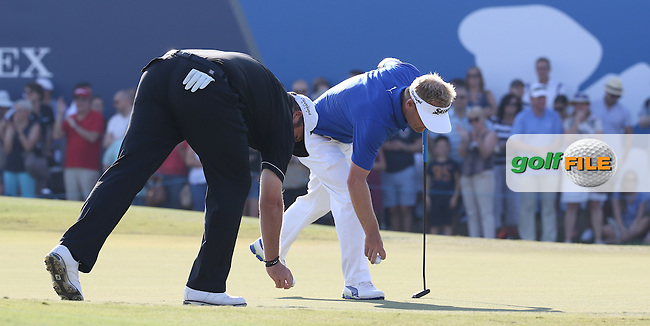 Erixon players Soren Kjeldsen (DEN) &amp; Shane Lowry (IRL) in action at the last during Round Two of the DP World Tour Championship 2016, played at the Jumeirah Golf Estates, Dubai, United Arab Emirates. 18/11/2016. Picture: David Lloyd | Golffile.<br /> <br /> All photo usage must display a mandatory copyright credit as: &copy; Golffile &amp; David Lloyd.