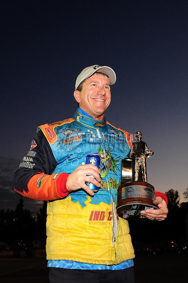 Nov. 13, 2011; Pomona, CA, USA; NHRA pro stock driver Greg Stanfield celebrates after winning the Auto Club Finals at Auto Club Raceway at Pomona. Mandatory Credit: Mark J. Rebilas-.