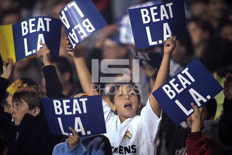 SAN JOSE, CA--A young San Jose Earthquakes fan cheers on his team before the start of the game against the visiting LA Galaxy. The LA Galaxy defeated the San Jose Earthquakes to win the first round playoffs with an aggregate score of three goals to one at Spartan Stadium in San Jose, California on Saturday, October 29, 2005. PHOTO BY DON FERIA. SATURDAY, OCTOBER 29 2005.