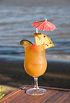 Hawaii: Molokai, Hotel Molokai, scene of Friday night entertainment by locals at the Hotel Molokai, with singers, ukulele strummers, hula dancers, and good food, such as coconut shrimp, and drink, such as rum mai tais. .Photo himolo181-71784..Photo copyright Lee Foster, www.fostertravel.com, lee@fostertravel.com, 510-549-2202