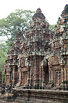Angkorian temple Banteay Srei (late 10th century) 967.<br /> Three sanctuary towers.The central sanctuary and the southern sanctuary were dedicated to Shiva and the northern sanctuary was dedicated to Vishnu.<br /> Banteay Srei temple is situated 20km north of Angkor, built during the reign of Rajendravarman by Yajnavaraha, one of his counsellors. In antiquity Isvarapura was a small city that grew up around the temple. Banteay Srei was dedicated to the worship of Shiva, the foundation stele describes the consecration of the linga Tribhuvanamahesvara (Lord of the three worlds) in 967.
